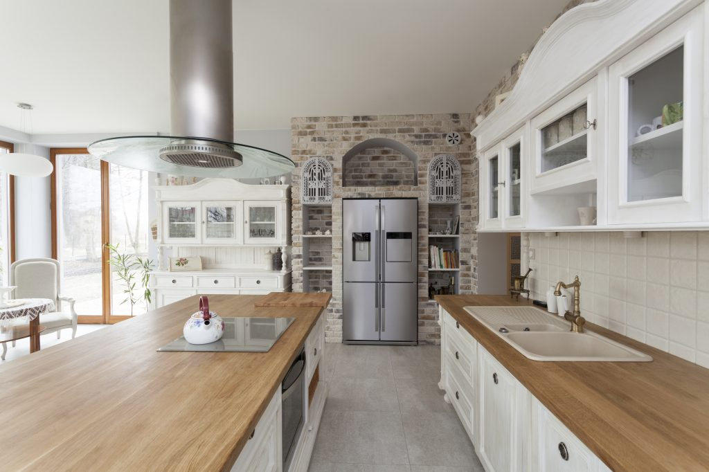 Give Your Traditional Kitchen A Modern Touch By Adding A Mix Of  Contemporary Tiles, Steel Appliances, And Open Shelving (a Key Design Style  For 2017).